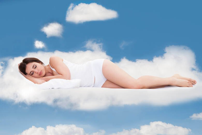 Woman-sleeping-on-a-cloud